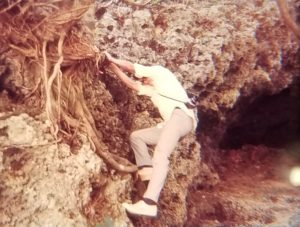 Man climbing a cliff in Okinawa