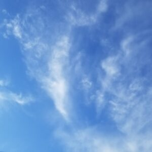 Blue sky with Whispy white Clouds
